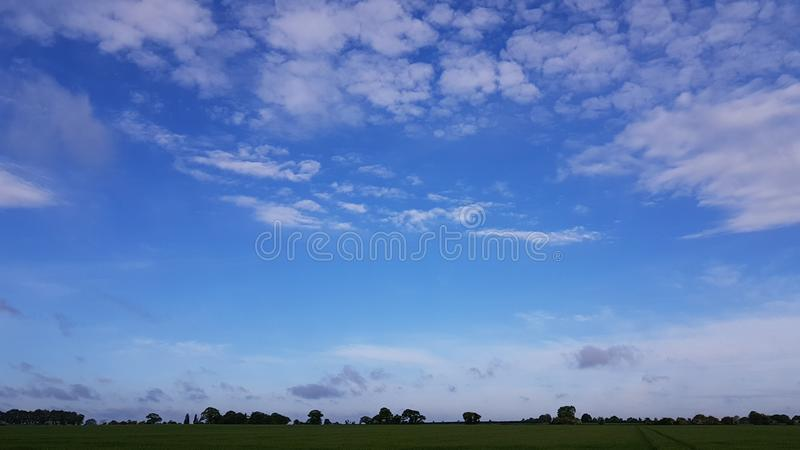 Light blue summer sky over field royalty free stock image