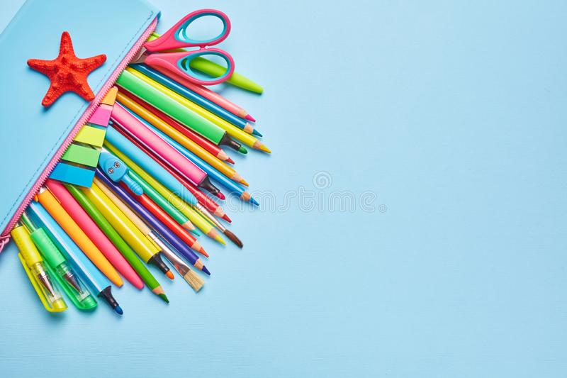 Stationery with copyspace. On the light blue table scattered a bright stationery royalty free stock photos