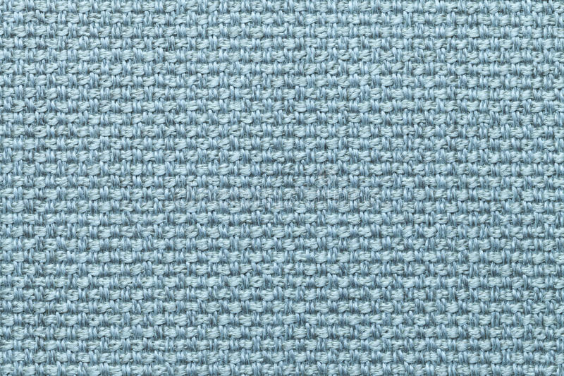 Light blue textile background with checkered pattern, closeup. Structure of the fabric macro. stock image