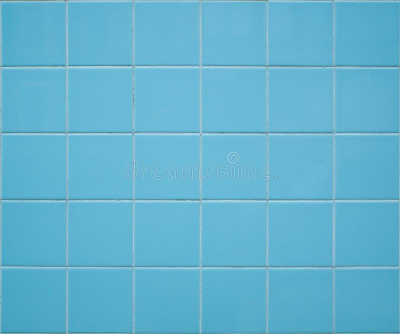 Light blue tiled wall background with square tiles. Geometric pattern, colorful pastel shades stock images