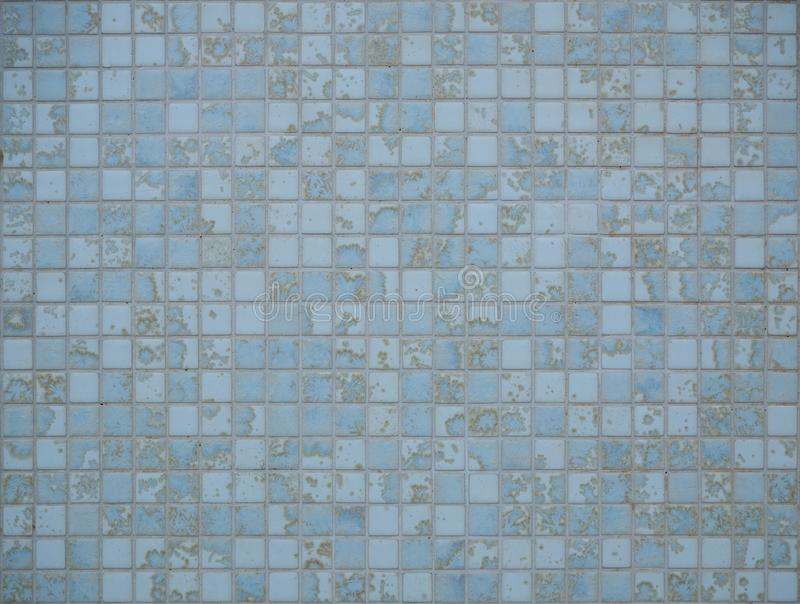 Light blue tiles pattern background. Pastel shades. Light blue tiles pattern background. Colorful, soft pastel shades of light and mid blue stock photo