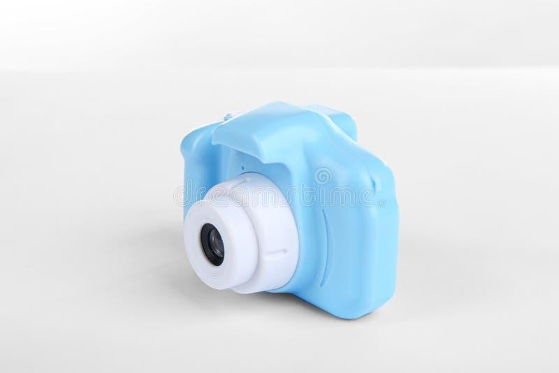 Light blue toy camera isolated. On white stock photo