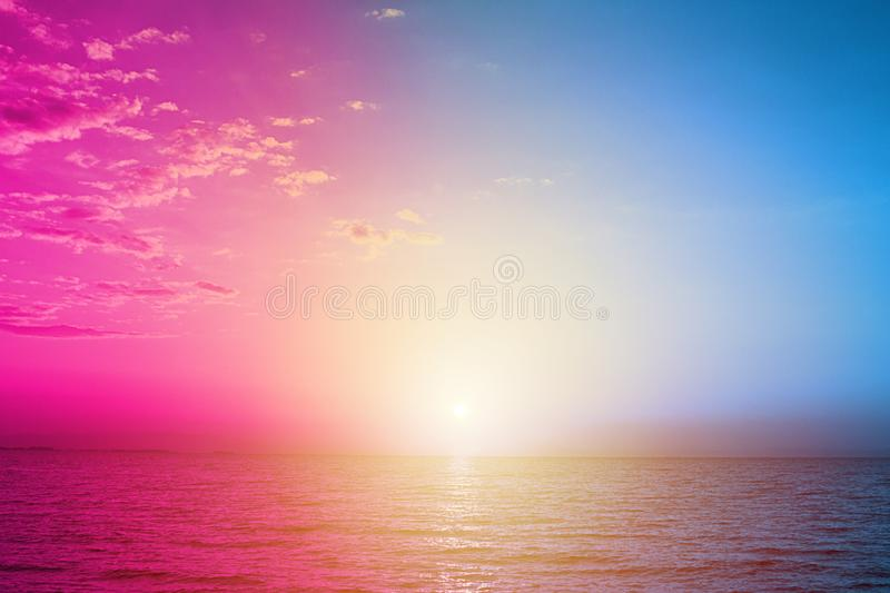 Light blue and violet neon background made of sea water or modern creative design. Creative fluorescent color layout made of sunset on the sea. Nature and summer stock photos