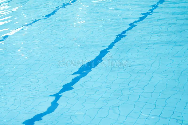 Light blue water with wave and ripple in swimming pool background stock photos