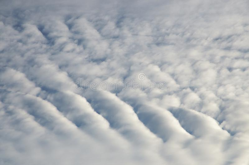 Light blue wavy surface of the clouds. royalty free stock image