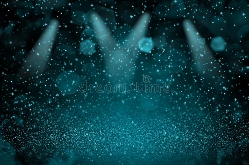 Light blue wonderful shiny glitter lights defocused stage spotlights bokeh abstract background with sparks fly, festal mockup text. Light blue wonderful bright royalty free stock image