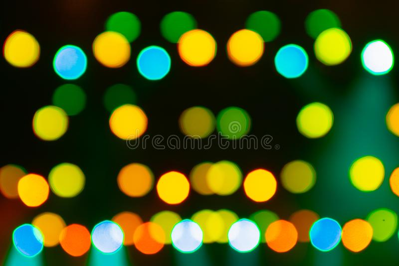 Light bokeh. Abstract blurred christmas background. Color circles in the lens blur zone.  stock photo
