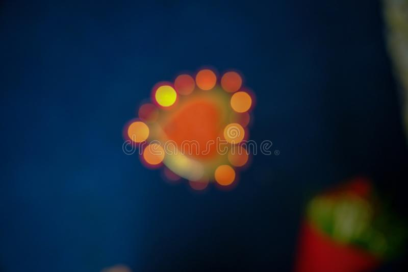 Light bokeh of heart shaped cake. Abstract background blur blurred bright christmas glitter glow glowing party shine shiny sparkle xmas royalty free stock image