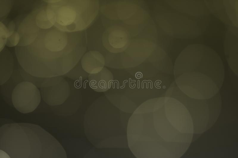 Light of bokeh water dot color yellow for background. Abstract, dark, flare, design, blue, black, texture, wallpaper, holiday, bright, space, macro royalty free stock image