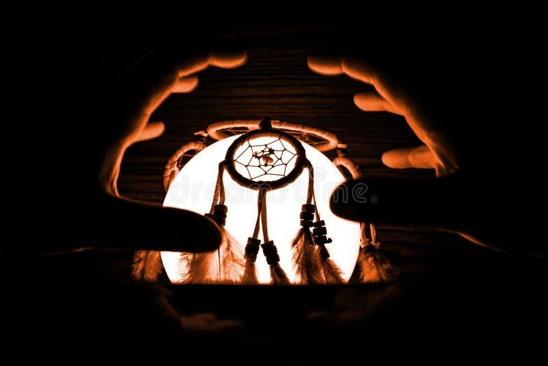 Light bowl with dream catcher, spooky halloween. Black background, dark royalty free stock photos