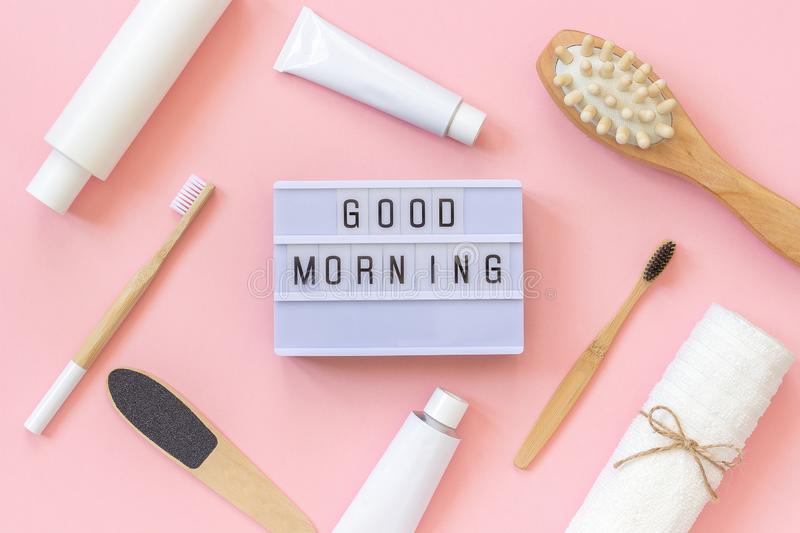 Light box text Good morning and set of cosmetics products and tools for shower or bath on pink background. Concept female morning. Body care, face, teeth for royalty free stock photo
