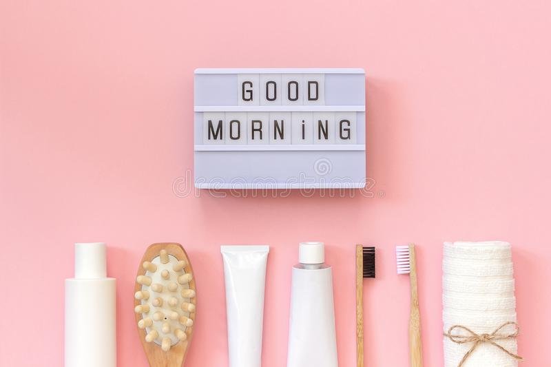 Light box text Good morning and set of cosmetics products and tools for shower or bath on pink background. Concept female morning. Body care, face, teeth for royalty free stock photography