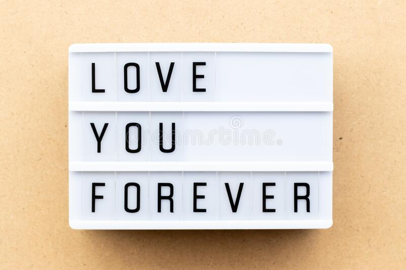Light box with word love you forever on wood background. Lightbox with word love you forever on wood background royalty free stock photos