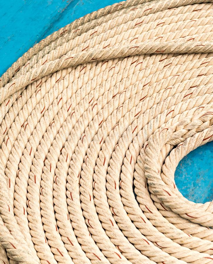 Light braided rope part of marine fasteners, folded in a circle close-up, empty space stock photography