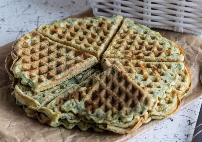 Home made waffles with spinach, heart shaped. Delicious breakfast stock photos