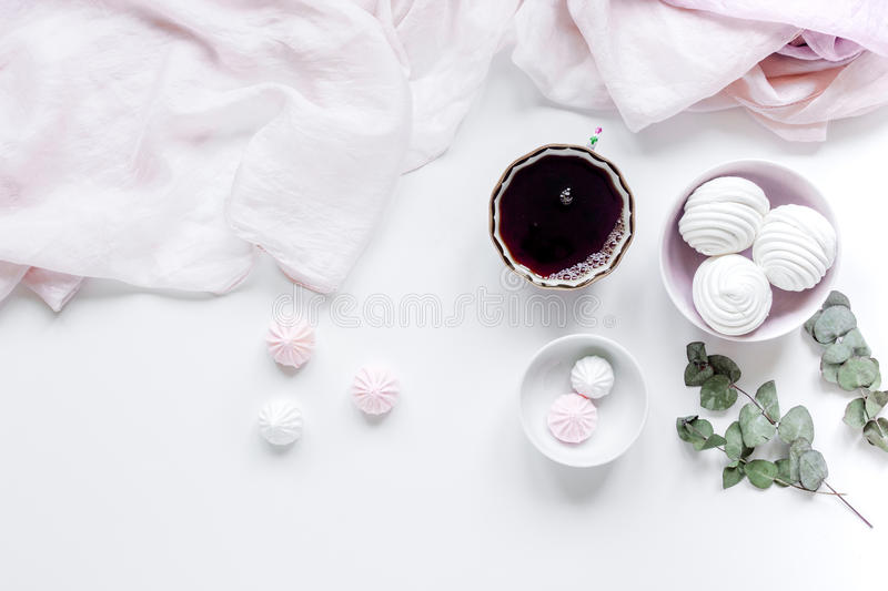 light breakfast with marsh-mallow and coffee on white table background top view stock photography