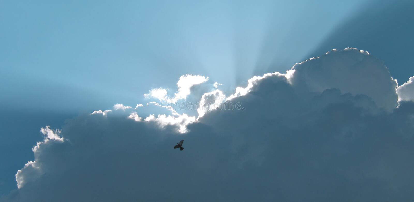 Light Breaking Behind Clouds royalty free stock image