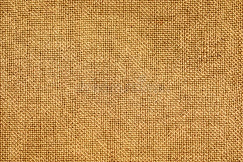 Light brown beige Sack burlap hemp fabric textured backgrounds royalty free stock image