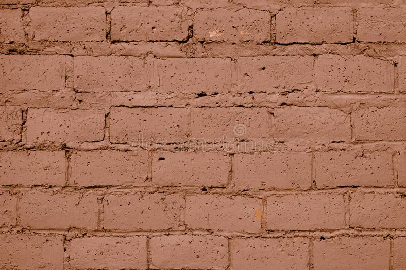 Light brown brick wall texture. Old red brick wall background. Light orange wall background. Clay colors pattern of brickwall. royalty free stock image