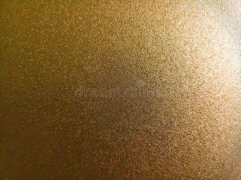 Light brown coloured shiny background with light and dark light effects,attractive wallpaper. Light brown coloured shiny background with light and dark light stock photo