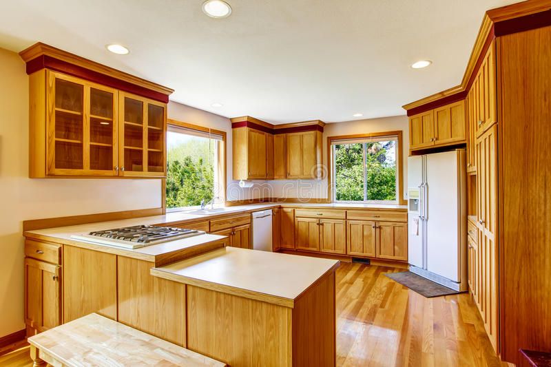 Light Brown Kitchen Cabinets, White Appliances And Hardwood Floor. Country  House Interior. Northwest, USA