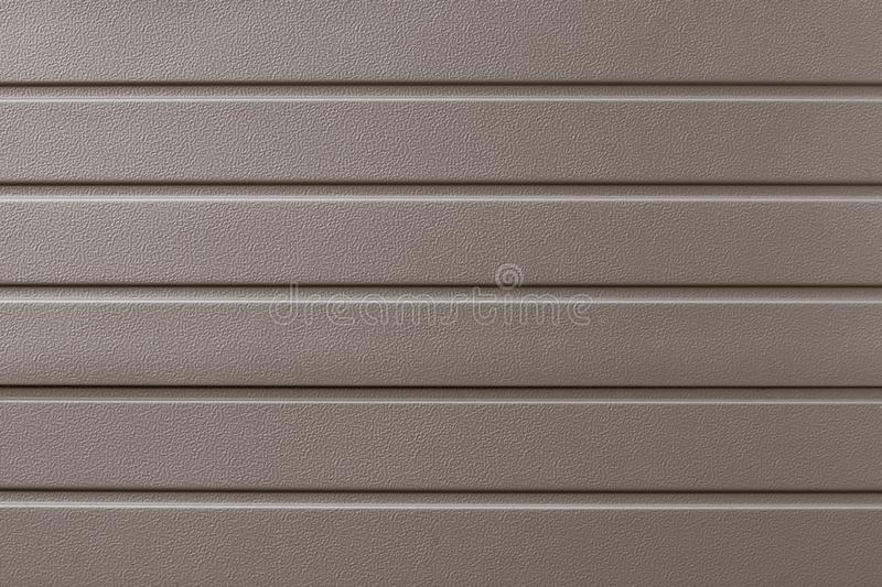 Light brown metallic ribbed surface. Abstract pattern. Beige metal backdrop. Gold industrial background of steel plate. Metalline. Wall siding, cladding stock photos