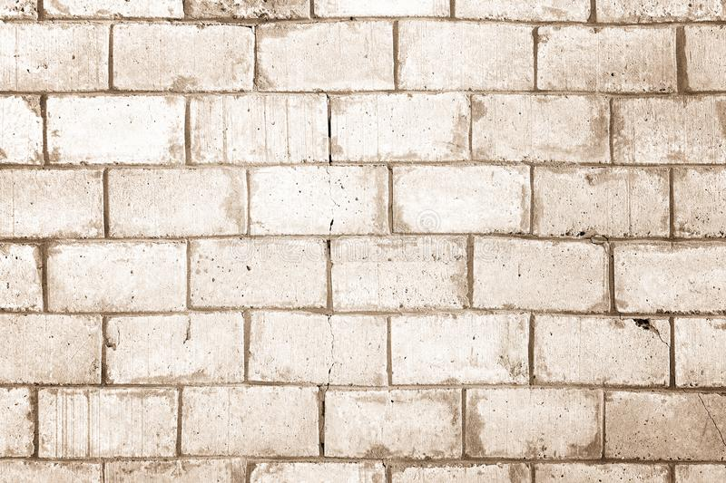 Light brown wall made of large bricks. Background with brickwork texture. royalty free stock photo