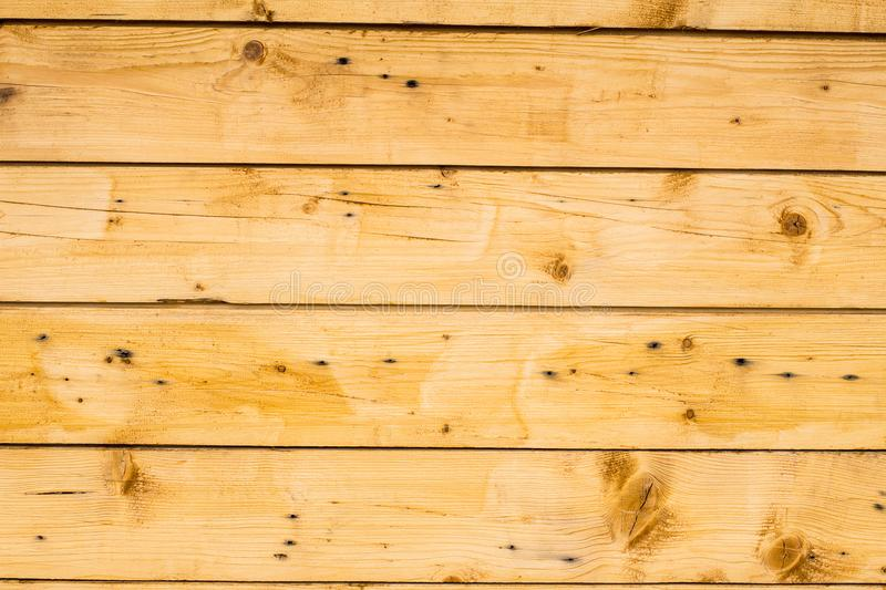 Light brown wooden planks, wall, table, ceiling or floor surface royalty free stock photo