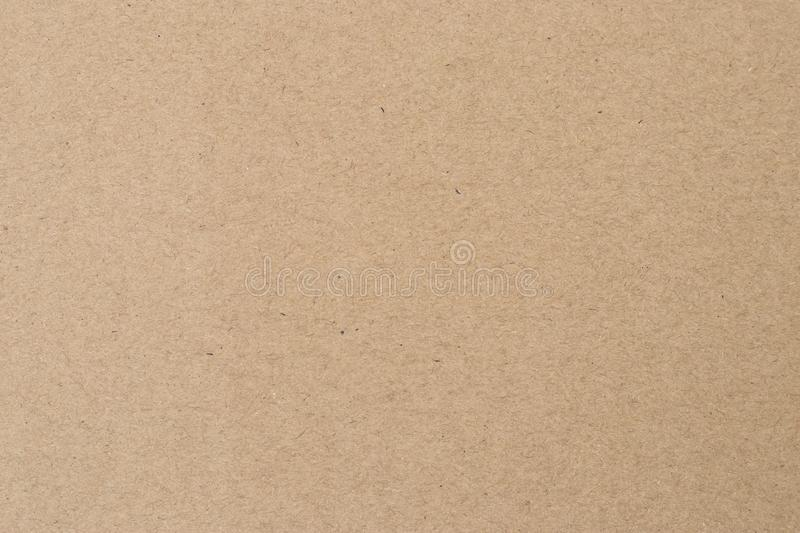 Light brown wrapping texture. Beige parchment, manuscript. Natural sheet surface. Old paper background. stock images