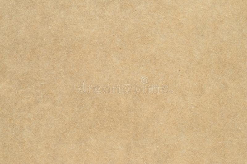 Light brown wrapping texture. Beige parchment, manuscript. Natural sheet surface. Old paper background. Yellow packaging, dirty ba royalty free stock photo