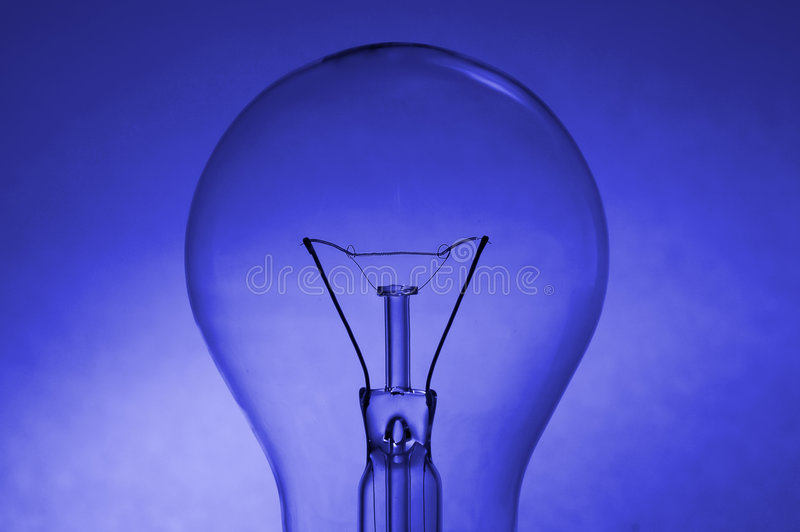 Light bulb. Silhouette over a coloured blue background stock photo