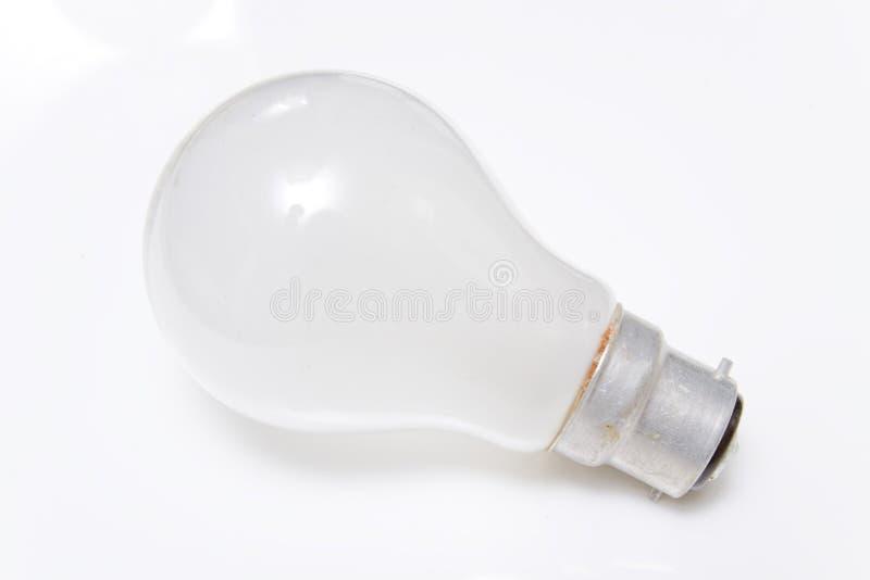 Light bulb. Bayonet cap light bulb isolated on white background royalty free stock images