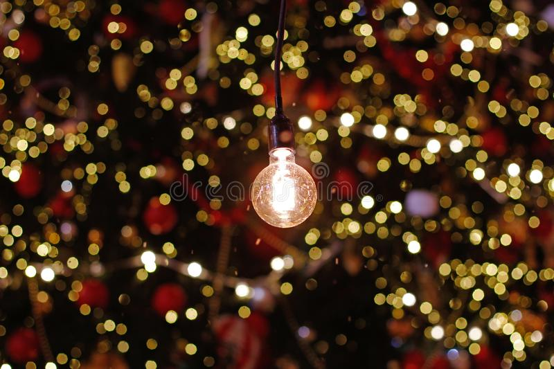 Light bulb in background of colorful defocused lights stock photos