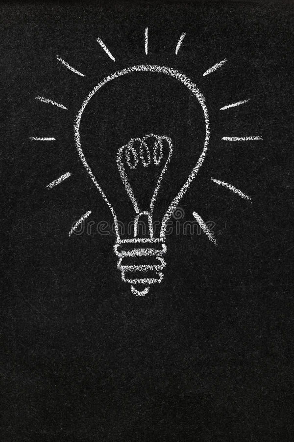 Light Bulb On A Blackboard With Copy Space Stock Image