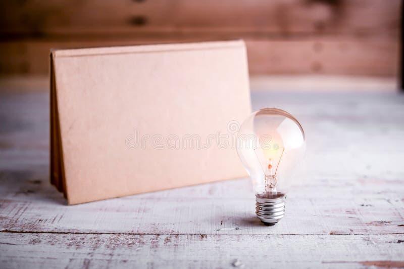 Light bulb and blank calendar stock photography