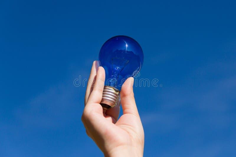 Light bulb and blue sky stock photography