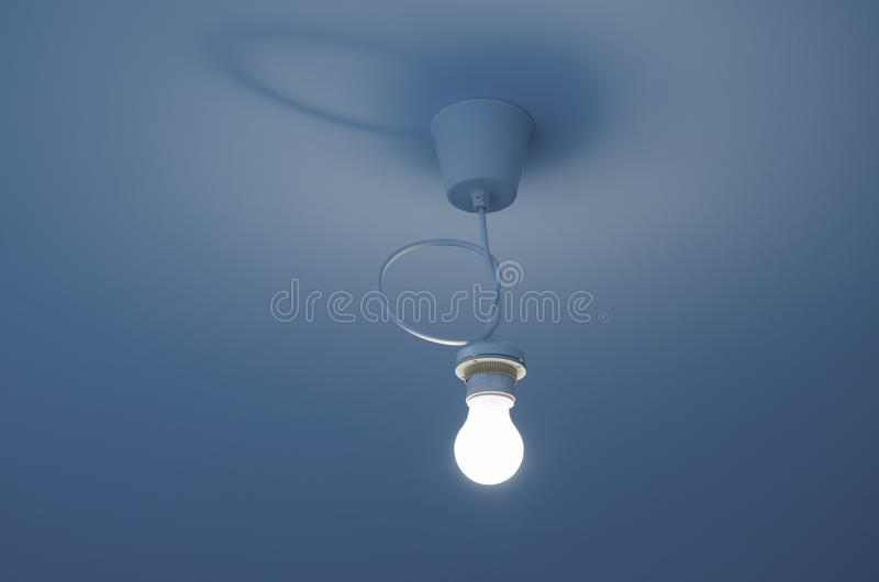 Light bulb on ceiling royalty free stock image