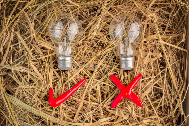 Light bulb with check mark stock images