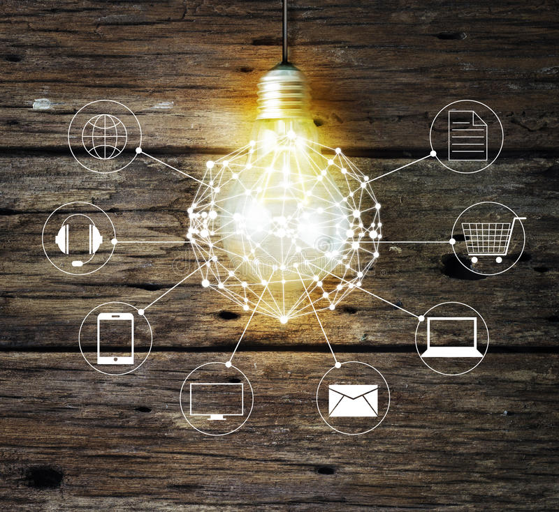 Light bulb circle global and icon customer network connection on wooden background. Omni Channel or Multi channel royalty free stock photo