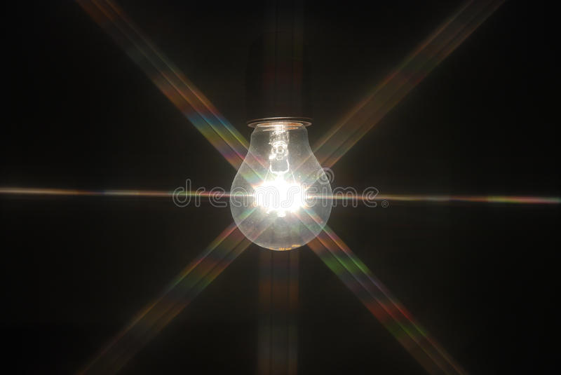 Light bulb in the dark royalty free stock images