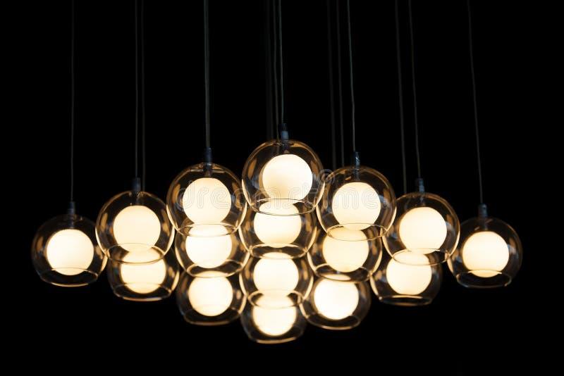 Light bulb on dark background, concept of creativity. royalty free stock photo