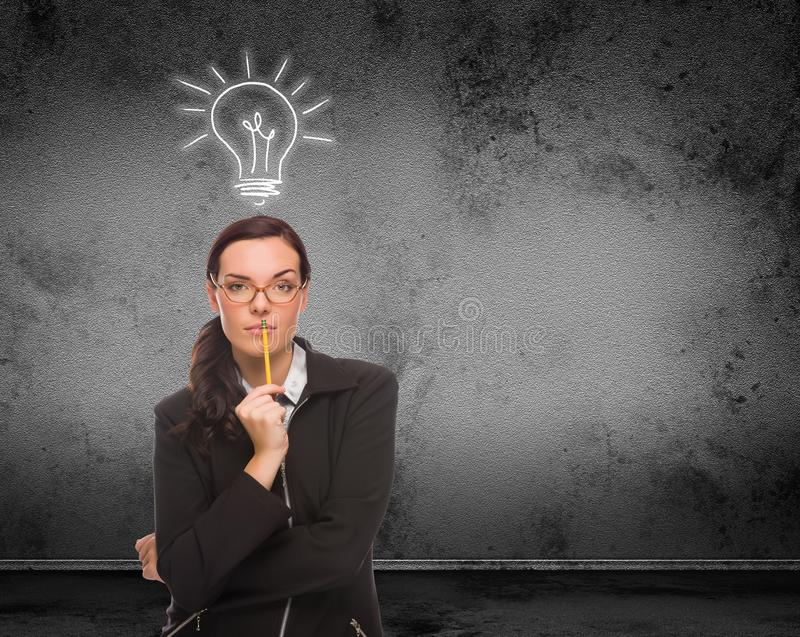 Light Bulb Drawn Above Head of Young Adult Woman With Pencil In Front of Wall with Copy Space stock photos