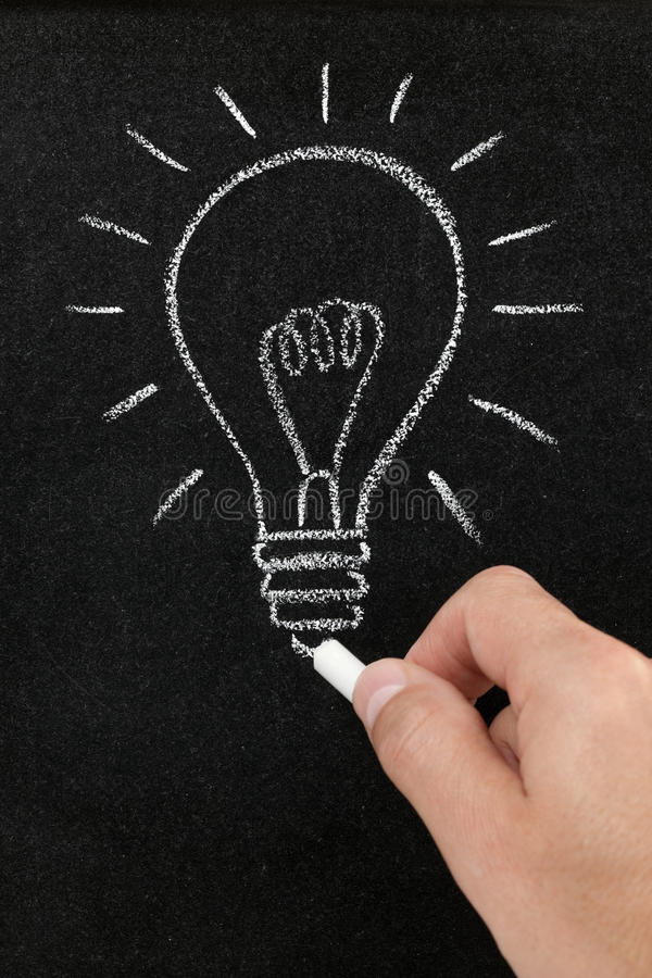 Light bulb drawn on a blackboard royalty free stock images