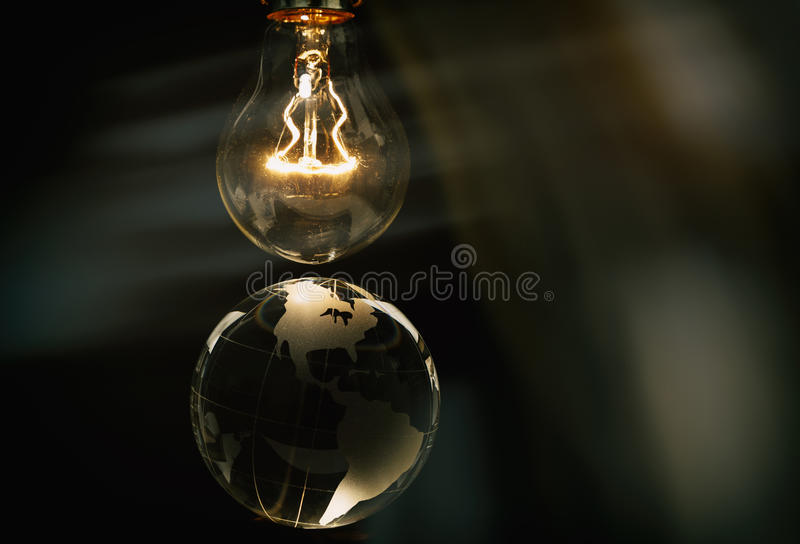Light bulb and earth. Concept of global issues royalty free stock photos