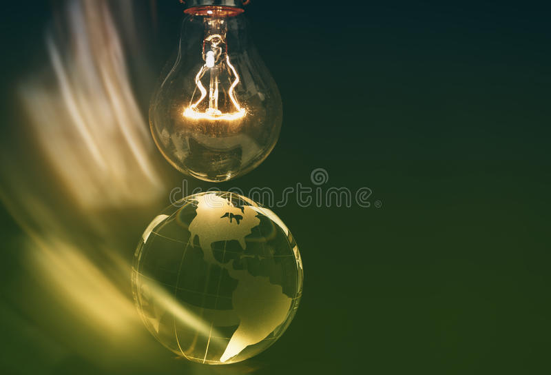 Light bulb and earth. Concept of global issues royalty free stock photography
