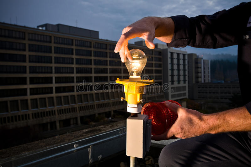 Light Bulb And Hands Stock Photography