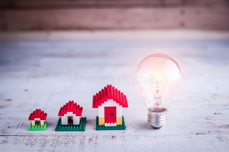 Light bulb with house model royalty free stock photography