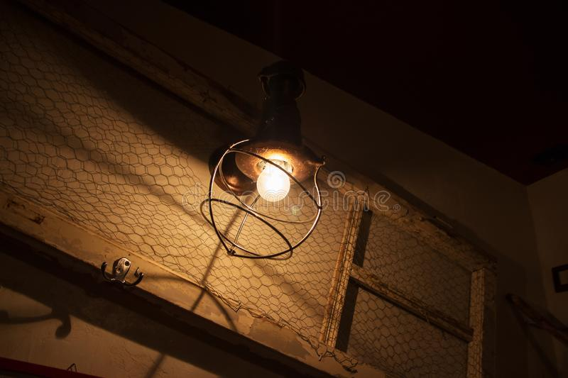 Light bulb and lamp in grunge style. warm tone photo royalty free stock images