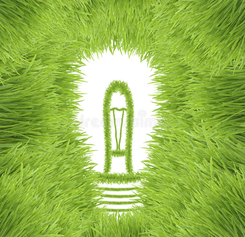 Light bulb made of green grass royalty free stock photo