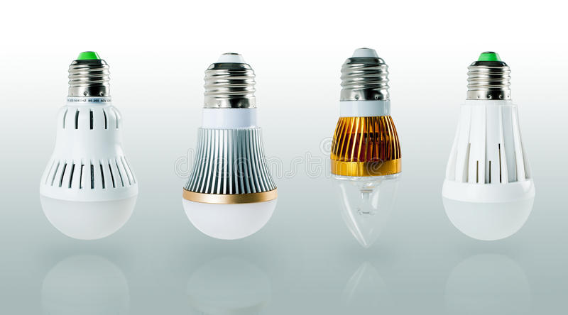 Light bulb. New generation on a grey background stock images